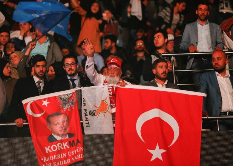 People cheer and wave flags during the Extraordinary Congress of the ruling AK Party (AKP) in Ankara, Turkey, May 21, 2017. REUTERS/Murad Sezer