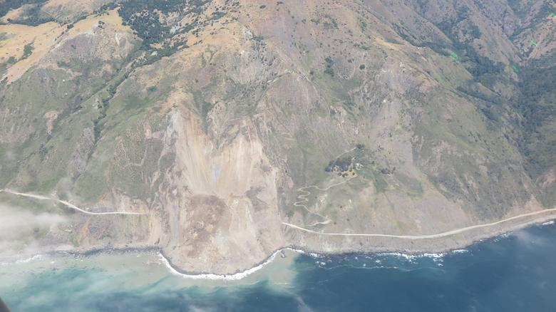 A massive landslide is seen in this Caltrans aerial photo of a quarter-mile section of State Route 1 about 100 miles south of San Jose, California, U.S. in this photo released on May 24, 2017.   Courtesy of John Madonna Construction/Caltrans/Handout via REUTERS