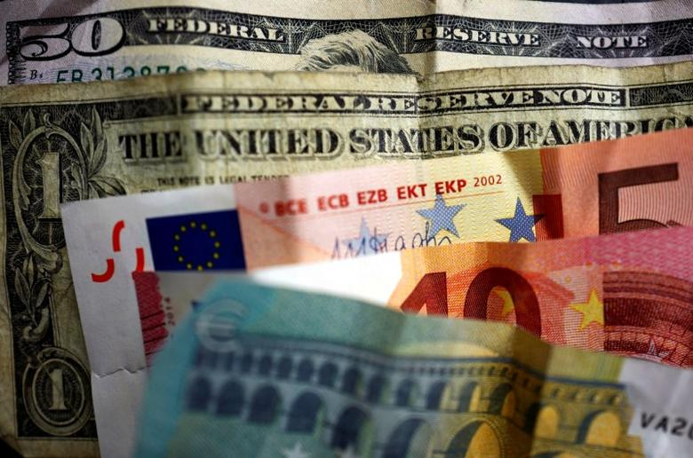 U.S. dollar and Euro bank notes are photographed in Frankfurt, Germany, in this illustration picture taken May 7, 2017. Picture taken May 7, 2017. REUTERS/Kai Pfaffenbach/Illustration