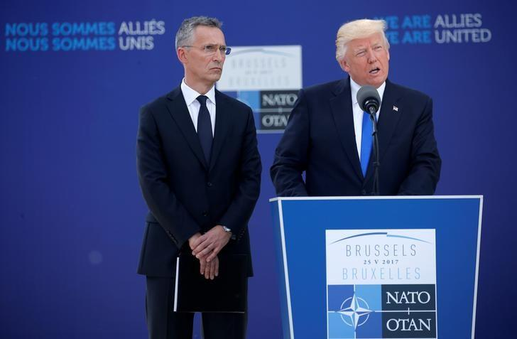 U.S. President Donald Trump speaks beside NATO Secretary General Jens Stoltenberg at the start of the NATO summit at their new headquarters in Brussels, Belgium, May 25, 2017.REUTERS/Jonathan Ernst