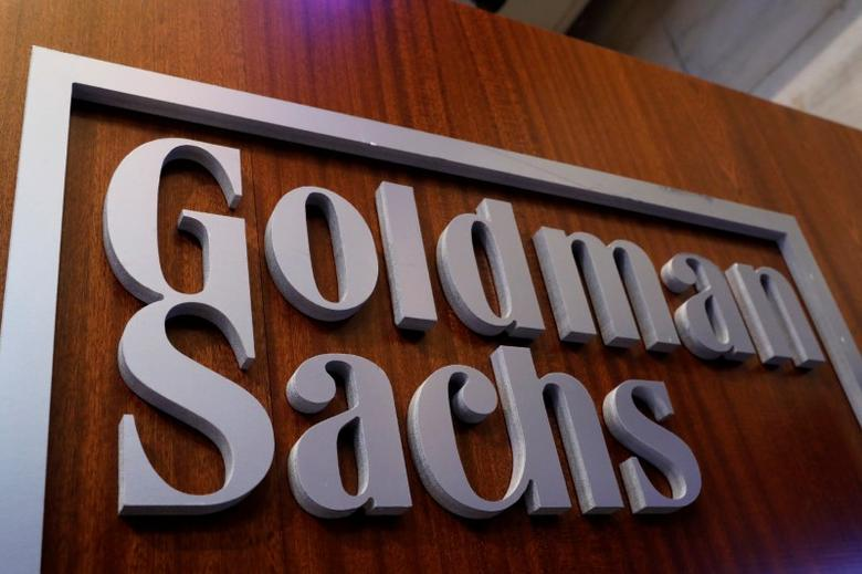 FILE PHOTO: A Goldman Sachs sign is displayed inside the company's post on the floor of the New York Stock Exchange (NYSE) in New York, U.S., April 18, 2017. REUTERS/Brendan McDermid