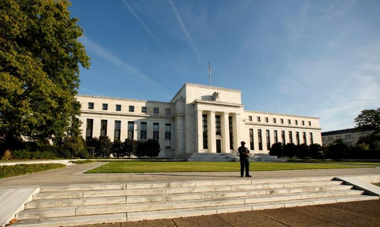 FILE PHOTO: A police officer keeps watch in front of the U.S. Federal Reserve building in Washington, DC, U.S. on October 12, 2016. REUTERS/Kevin Lamarque/File Photo