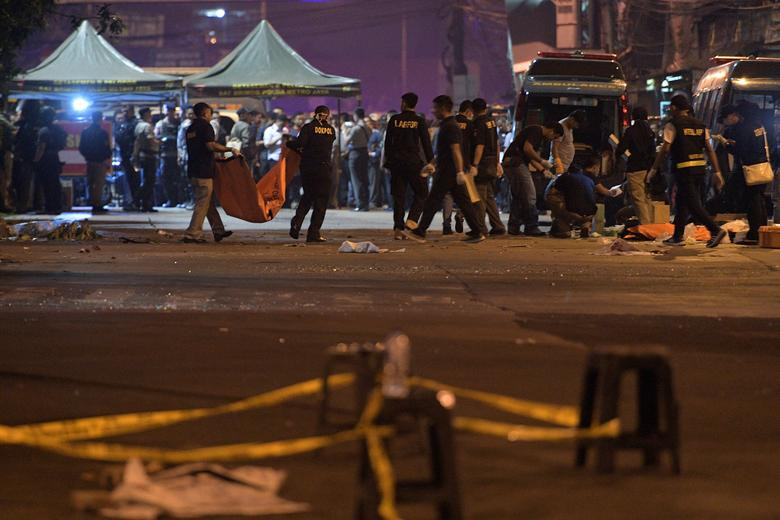 Police investigate the scene of an explosion at a bus station in Kampung Melayu, East Jakarta, Indonesia.  Antara Foto/Sigid Kurniawan/ via REUTERS