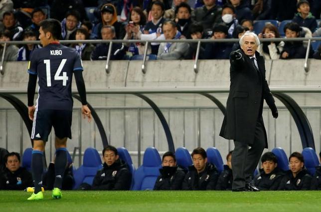 5月25日、日本サッカー協会は2018年W杯アジア最終予選のイラク戦などに臨むメンバーを発表し、ベルギー1部のヘントで好調の久保裕也(写真左)、ブルガリアでプレーする加藤恒平などが選出された。写真右はバヒド・ハリルホジッチ監督。3月撮影(2017年 ロイター/Toru Hanai)