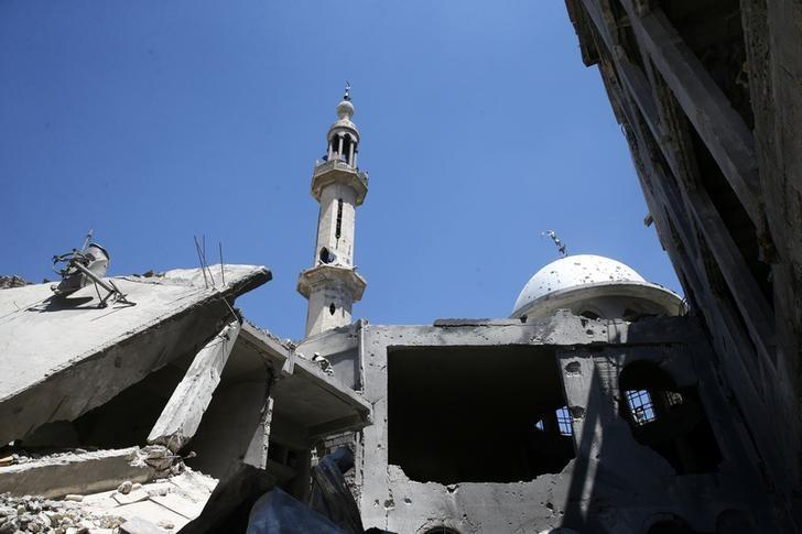 A damaged mosque is seen in the rebel held besieged eastern Damascus suburb of Ghouta, Syria May 24, 2017. REUTERS/Bassam Khabieh