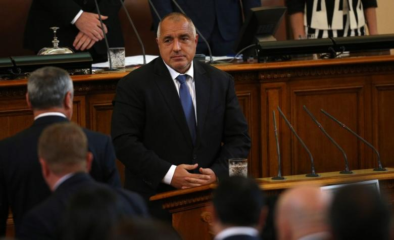 Bulgaria's Prime Minister Boiko Borisov looks at members of his cabinet before taking an oath during a swearing-in ceremony in the parliament in Sofia, Bulgaria May 4, 2017. REUTERS/Stoyan Nenov