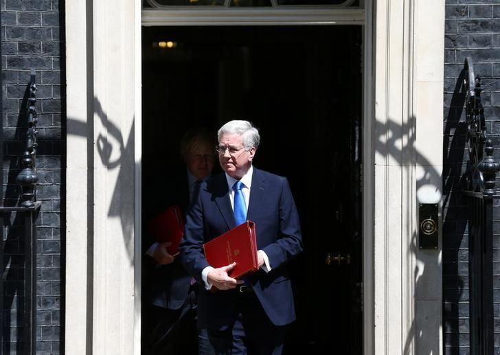 Britain's Defence Secretary Michael Fallon and Britain's Foreign Secretary Boris Johnson leave number 10 Downing Street in London, Britain, May 25, 2017. REUTERS/Neil Hall
