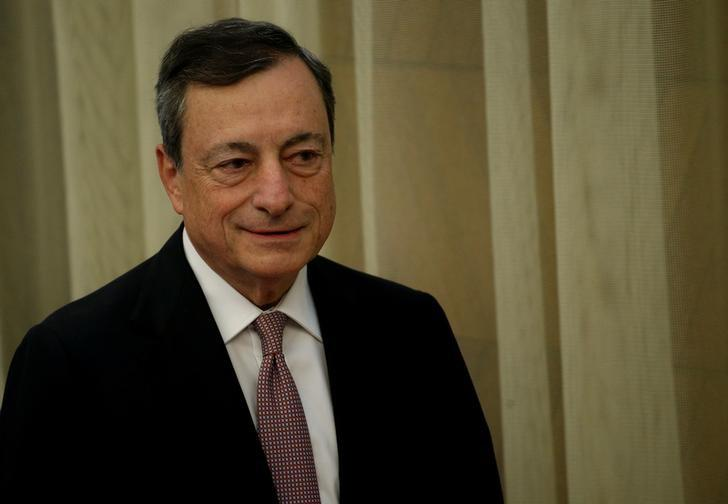 FILE PHOTO: European Central Bank (ECB) President Mario Draghi stands before delivering his speech during an event at Bank of Spain headquarters in Madrid, Spain May 24, 2017. REUTERS/Juan Medina
