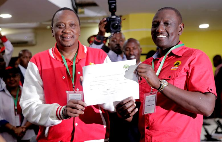 Kenya's President Uhuru Kenyatta (L) of the Jubilee Party and his Deputy William Ruto display their clearance certificate from the Independent Electoral and Boundaries Commission (IEBC) after presenting their candidacy for the presidential race in Nairobi, Kenya, May 29, 2017. REUTERS/Thomas Mukoya