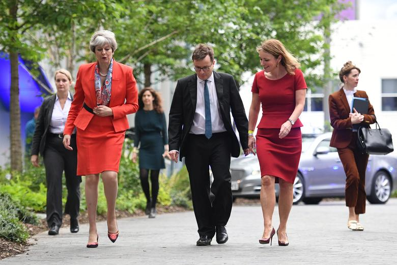 Prime Minister Theresa May (L) arrives at Sky studios in Osterley, west London, alongside Sky News head John Ryley and Channel 4Õs chief creative officer Jay Hunt, to take part in a joint Channel 4 and Sky News general election programme, May 29, 2017. REUTERS/Stefan Rousseau/Pool