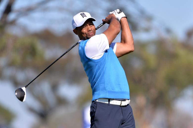 FILE PHOTO: Tiger Woods tees off the 5th hole during the first round of the Farmers Insurance Open golf tournament at Torrey Pines Municipal Golf Course in La Jolla, California January 26, 2017. Mandatory Credit: Orlando Ramirez-USA TODAY Sports/File Photo