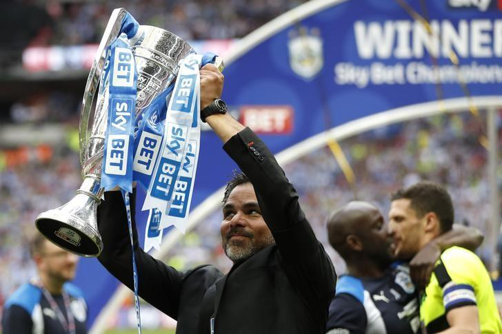 Britain Football Soccer - Reading v Huddersfield Town - Sky Bet Championship Play-Off Final - Wembley Stadium, London, England - 29/5/17 Huddersfield Town manager David Wagner celebrates with the trophy after winning the Sky Bet Championship Play-Off Final and getting promoted to the Premier League  Action Images via Reuters / John Sibley Livepic