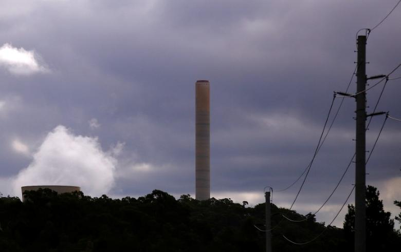 Power lines are be seen in front of chimneys from the coal-powered Mount Piper power station near the town of Lithgow, located west of Sydney in Australia, February 26, 2017. REUTERS/David Gray