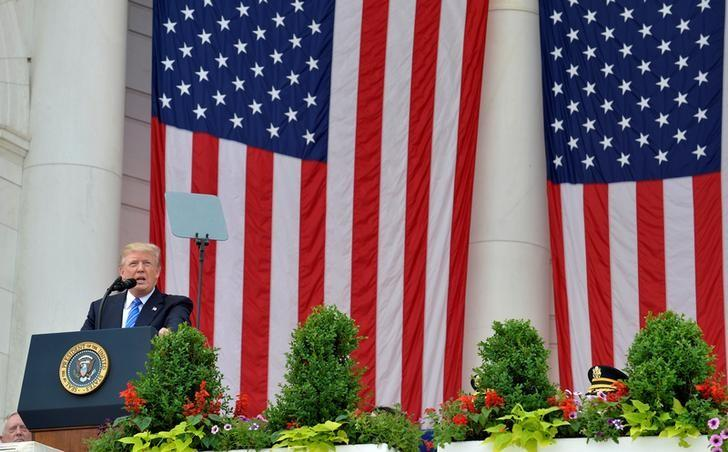 President Donald Trump makes remarks at the Amphitheater after laying a wreath at the Tomb of the Unknown Soldier at Arlington National Cemetery as part of Memorial Day observance, Arlington, Virginia, U.S., May 29, 2017. REUTERS/Mike Theiler/Files