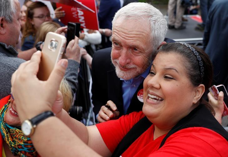 Jeremy Corbyn, leader of Britain's opposition Labour Party, poses for a selfie at a campaign event in Reading, May 31, 2017. REUTERS/Peter Nicholls