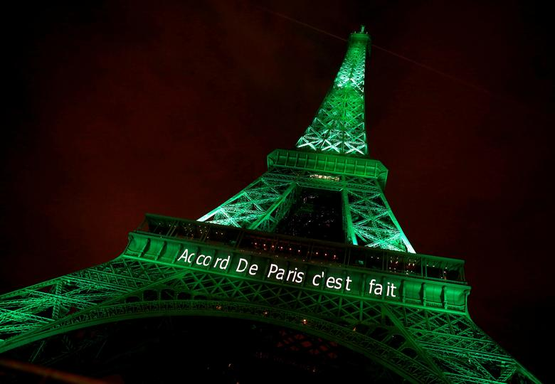 FILE PHOTO: The Eiffel tower is illuminated in green with the words ''Paris Agreement is Done'', to celebrate the Paris U.N. COP21 Climate Change agreement in Paris, France, November 4, 2016. REUTERS/Jacky Naegelen/File Photo
