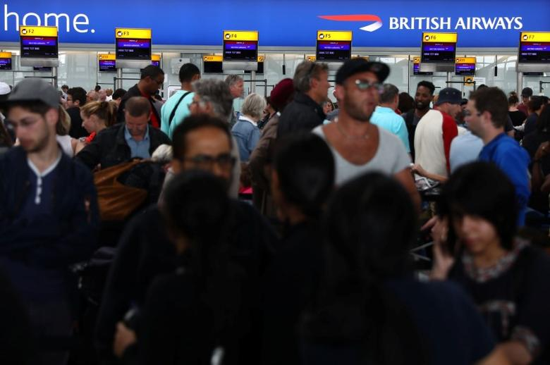 People wait with their luggage at the British Airways check in desks at Heathrow Terminal 5 in London, Britain May 28, 2017. REUTERS/Neil Hall
