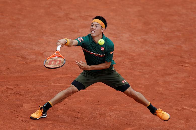 Japan's Kei Nishikori in action during his first round match against Australia's Thanasi Kokkinakis. REUTERS/Gonzalo Fuentes