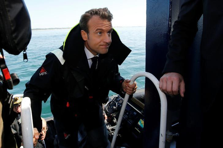 French President Emmanuel Macron climbs aboard the Abeille Bourdon during a visit off the Atlantic Ocean waters of Lorient, France, June 1, 2017.   REUTERS/Stephane Mahe