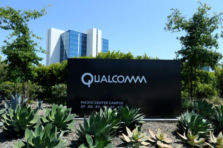 FILE PHOTO: A Qualcomm sign is pictured at one of its many campus buildings in San Diego, California, U.S. April 18, 2017.  REUTERS/Mike Blake/File Photo