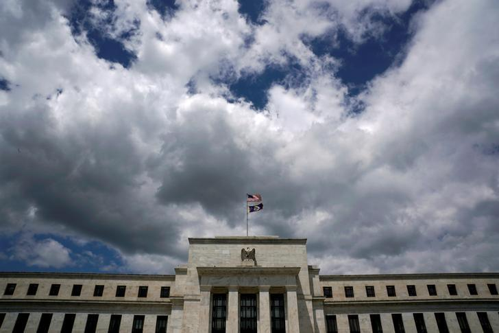 Flags fly over the Federal Reserve Headquarters on a windy day in Washington, U.S., May 26, 2017. REUTERS/Kevin Lamarque