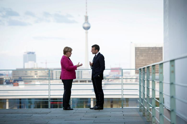German Chancellor Angela Merkel and French President Emmanuel Macron meet at the Chancellery in Berlin, Germany May 15, 2017. Guido Bergmann/Courtesy of Bundesregierung/Handout via REUTERS