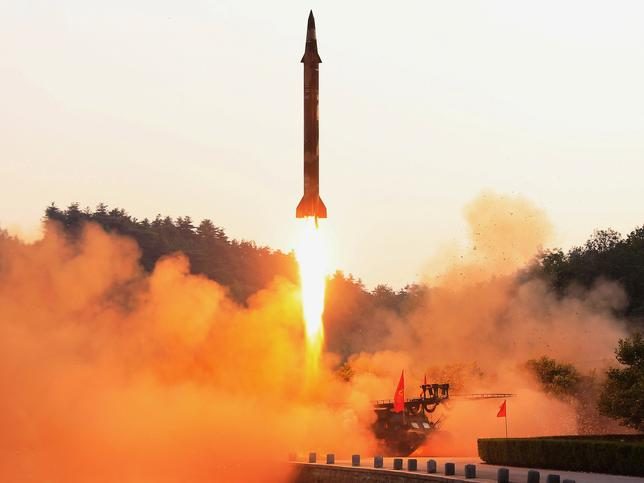 FILE PHOTO: A ballistic rocket is test-fired through a precision control guidance system in this undated photo released by North Korea's Korean Central News Agency (KCNA) May 30, 2017. KCNA/via REUTERS/File Photo