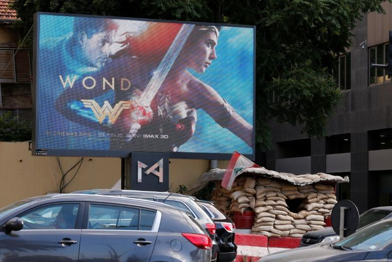 An advertisement of ''Wonder Woman'' movie is pictured near an army post in Beirut, Lebanon May 31, 2017. REUTERS/Mohamed Azakir
