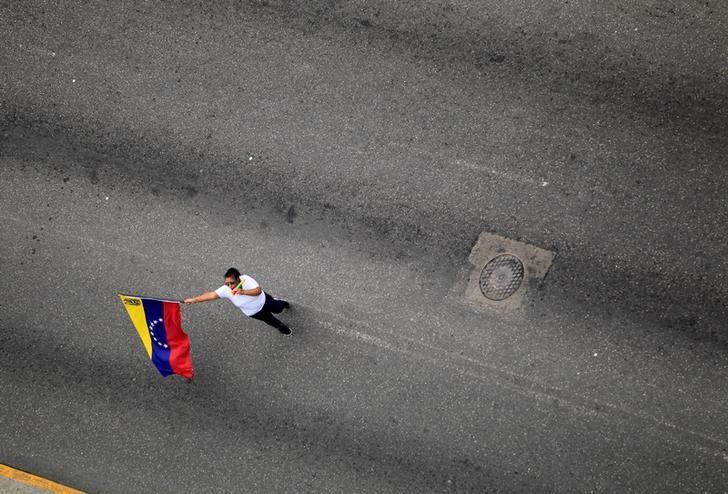 An opposition supporter rally against Venezuela's President Nicolas Maduro in Caracas, Venezuela, June 2, 2017. REUTERS/Christian Veron