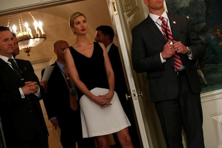 Ivanka Trump (C) looks on as her father U.S. President Donald Trump prepares to sign two bills boosting government support for law enforcement first responders, surrounded by law enforcement organization leaders at the White House in Washington, U.S. June 2, 2017.  REUTERS/Jonathan Ernst