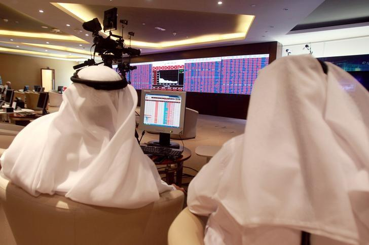 Traders monitor screens displaying stock information at Qatar Stock Exchange in Doha, Qatar June 5, 2017. REUTERS/Stringer