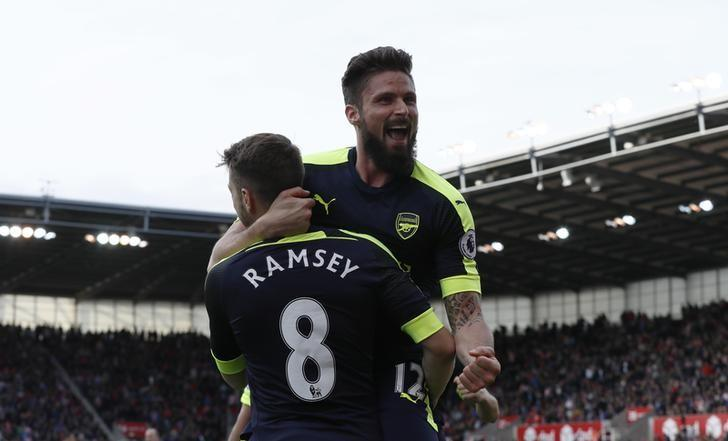 Britain Football Soccer - Stoke City v Arsenal - Premier League - bet365 Stadium - 13/5/17 Arsenal's Olivier Giroud celebrates scoring their fourth goal with Aaron Ramsey  Reuters / Stefan Wermuth Livepic