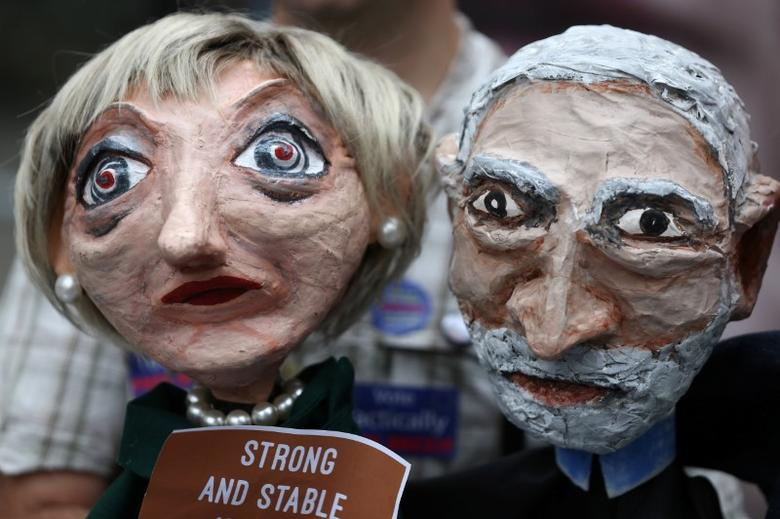 Puppets of Conservative Party leader Theresa May and Labour Party leader Jeremy Corbyn are seen during a protest against the BBC's broadcast restrictions on the Captain Ska song ''Liar Liar'' outside Broadcasting House in London, Britain June 2, 2017. REUTERS/Neil Hall