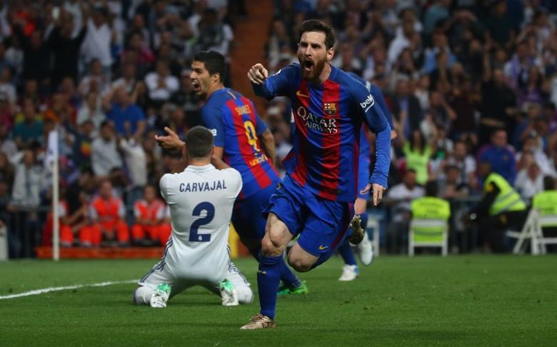 Football Soccer - Real Madrid v FC Barcelona - Spanish Liga Santander - Santiago Bernabeu, Madrid, Spain - 23/4/17 Barcelona's Lionel Messi celebrates scoring their third goal  Reuters / Stringer Livepic