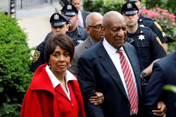 Actor and comedian Bill Cosby leaves with John Atchison and Sheila Frazier after the third day of Cosby's sexual assault trial at the Montgomery County Courthouse in Norristown, Pennsylvania, U.S. June 7, 2017. REUTERS/Brendan McDermid