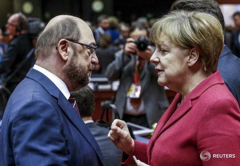 European Parliament President Martin Schulz (L) and German Chancellor Angela Merkel attend a European Union leaders summit over migration, in Brussels, Belgium, March 17, 2016. REUTERS/Yves Herman