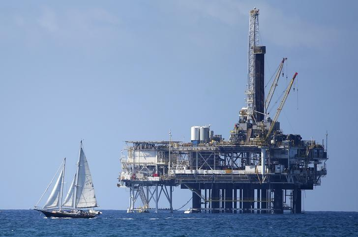 FILE PHOTO: An offshore oil platform is seen in Huntington Beach, California September 28, 2014. REUTERS/Lucy Nicholson