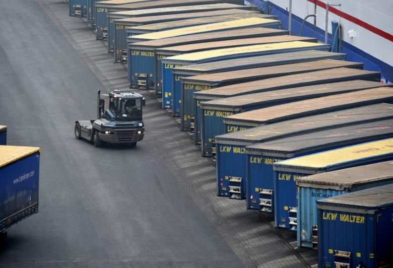 FILE PHOTO: Containers are pictured at a loading terminal in the port of Kiel, Germany, January 25, 2017. REUTERS/Fabian Bimmer/File Photo