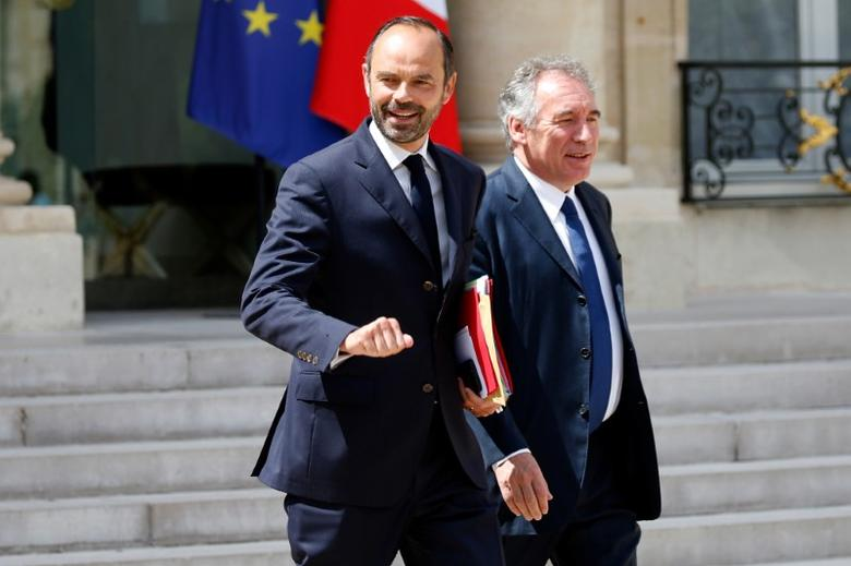 French Prime Minister Edouard Philippe (L) and French Justice Minister Francois Bayrou (R) leave the Elysee Palace after a weekly cabinet meeting in Paris, France, May 31, 2017. REUTERS/Charles Platiau