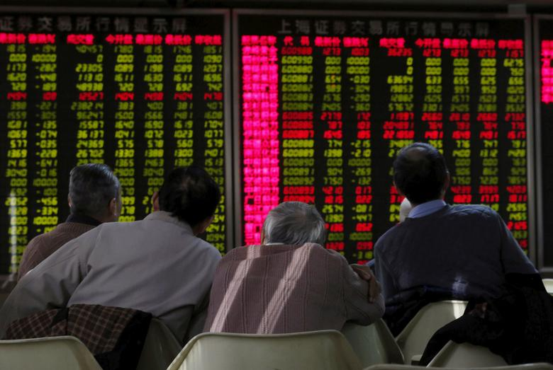 FILE PHOTO: Men look at an electronic board showing stock market information at a brokerage house in Beijing, China January 5, 2016. REUTERS/Kim Kyung-Hoon/File Photo