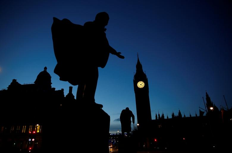 David Lloyd George's statue is pictured with the Parliament in the background on the night of Britain's general election in London, June 9, 2017. REUTERS/Stefan Wermuth