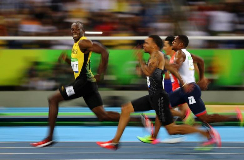 FILE PHOTO: Usain Bolt of Jamaica smiles as he looks back at his competition, whilst winning the 100-meter semi-final sprint, at the 2016 Olympics in Rio de Janeiro, Brazil. REUTERS/Kai Pfaffenbach