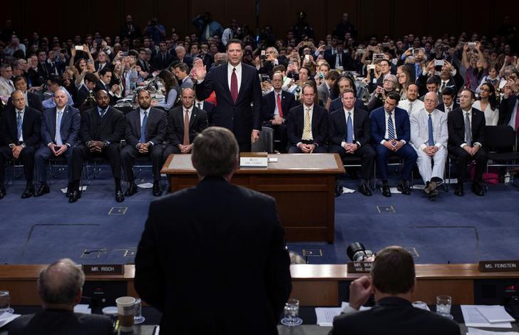 Former FBI Director James Comey is sworn in to testify before a Senate Intelligence Committee hearing on ''Russian Federation Efforts to Interfere in the 2016 U.S. Elections'' on Capitol Hill in Washington, U.S. June 8, 2017. REUTERS/Doug Mills/POOL