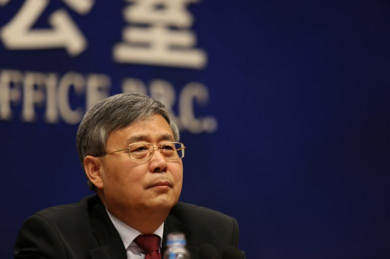 FILE PHOTO: Guo Shuqing, China banking regulator, attends a news conference ahead of China's parliament in Beijing, March 2, 2017. REUTERS/Shu Zhang