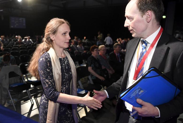 Finnish politician and a member of the European Parliament Jussi Halla-aho is congratulated by his wife, Hilla after being elected a new chairman of the Finns Party at the congress in Jyvaskyla, Finland, June 10, 2017. LEHTIKUVA/Jussi Nukari via REUTERS