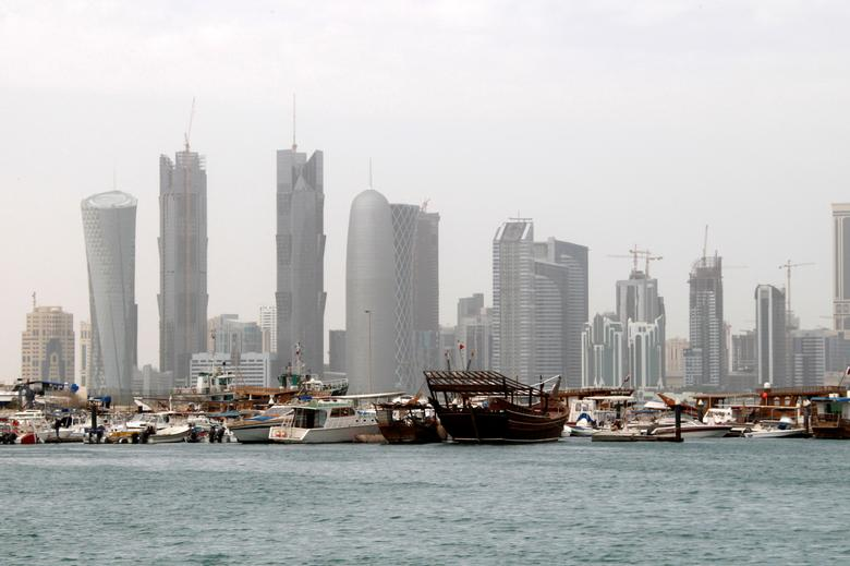 FILE PHOTO: A traditional wooden fishing Dhow is seen in port near modern glass and steel buildings on the Doha skyline, Qatar February 9, 2010.     REUTERS/Jacky Naegelen/File Photo