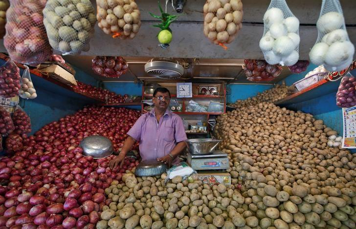 FILE PHOTO: A vendor waits for customers at his vegetable stall at a wholesale fruit and vegetable market in Mumbai, February 13, 2017. REUTERS/Shailesh Andrade/File Photo