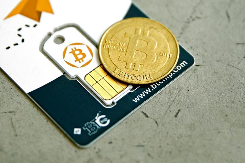 A Bitcoin (virtual currency) hardware wallet and a coin are seen in an illustration picture taken at La Maison du Bitcoin in Paris, France, May 27, 2015. REUTERS/Benoit Tessier