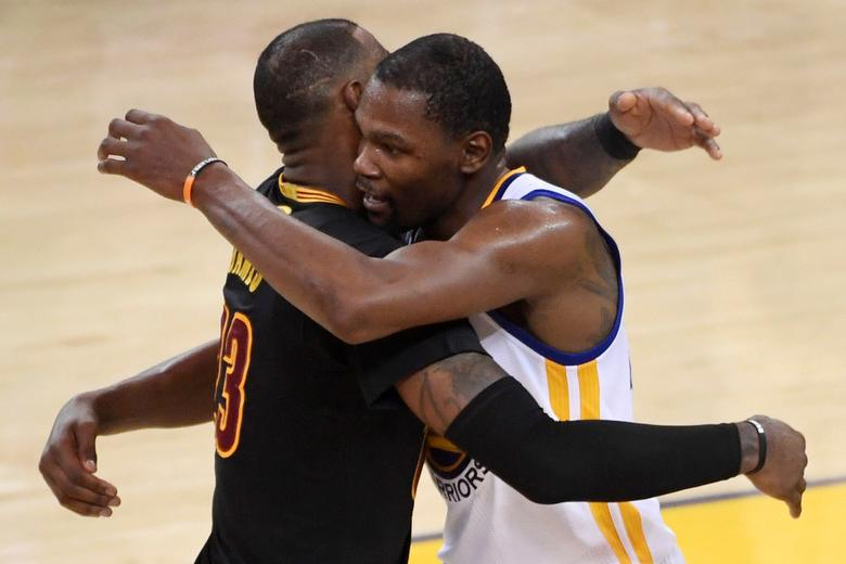 Jun 12, 2017; Oakland, CA, USA; Golden State Warriors forward Kevin Durant (35) hugs Cleveland Cavaliers forward LeBron James (23) after game five of the 2017 NBA Finals at Oracle Arena. Mandatory Credit: Kyle Terada-USA TODAY Sports