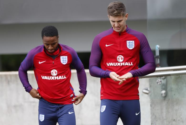 Britain Football Soccer - England Training - St. George' Park, Burton upon Trent - June 9, 2017 England's Raheem Sterling and John Stones during training Action Images via Reuters / Carl Recine Livepic